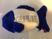 """blue and white fish-shaped stuffed toy with """"gefilte"""" written on it"""