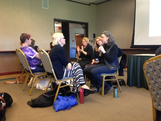 Guiding Eyes grads and interpreters attend a talk on how dogs' genetics influence their behavior.