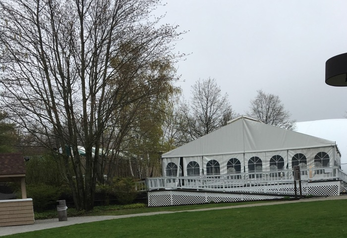 A large white structure that served as the dog play pavilion at the Guiding Eyes seminar