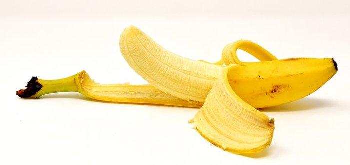 A partially peeled banana