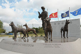 statues of 4 dogs and a soldier at the military dog national monument