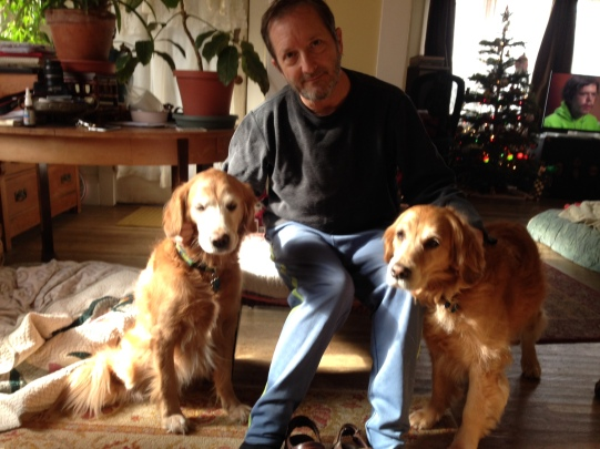 Dora, left, and Cali, right, sit with Dora's dad