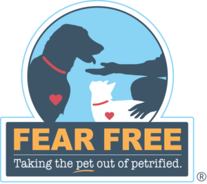 "Fear Free logo with silhouette of a dog, a cat, and an outstreched hand reads ""taking the pet out of petrified"""