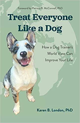 cover of Treat Everyone Like a Dog with a happy cattle dog puppy